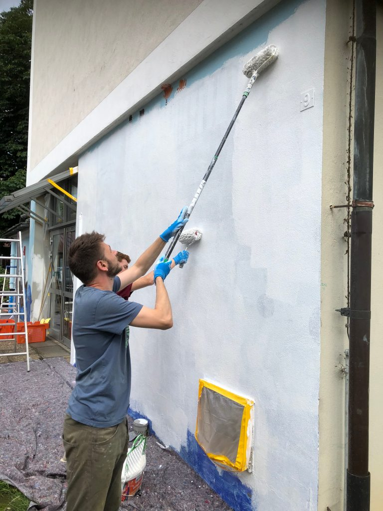 The mural is primed white